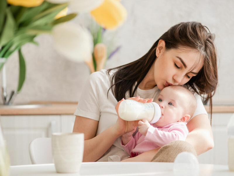 mom feeding her baby with a bottle