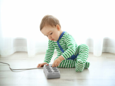child playing with electical outlet